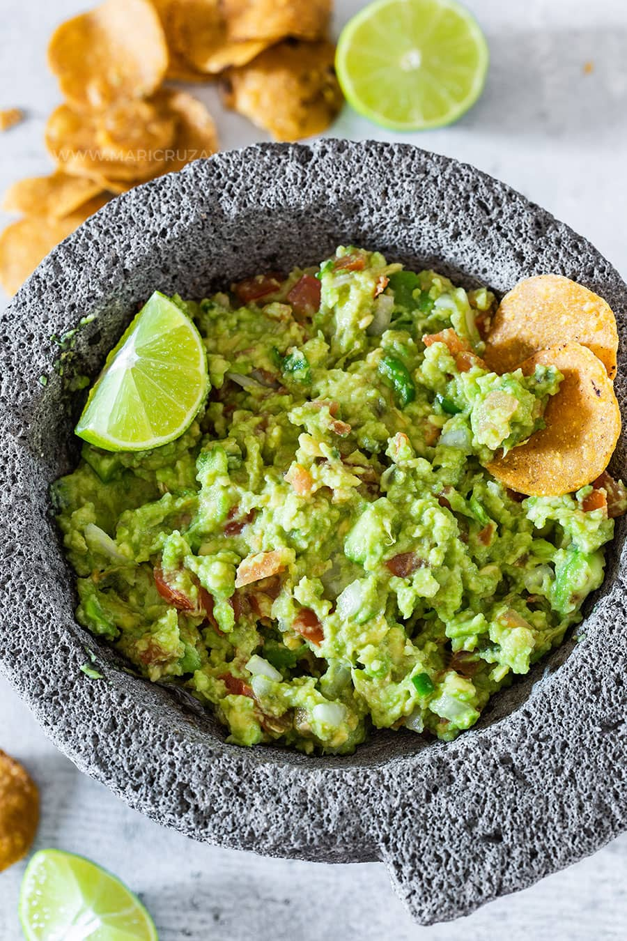 A molcajete with guacamole from above.