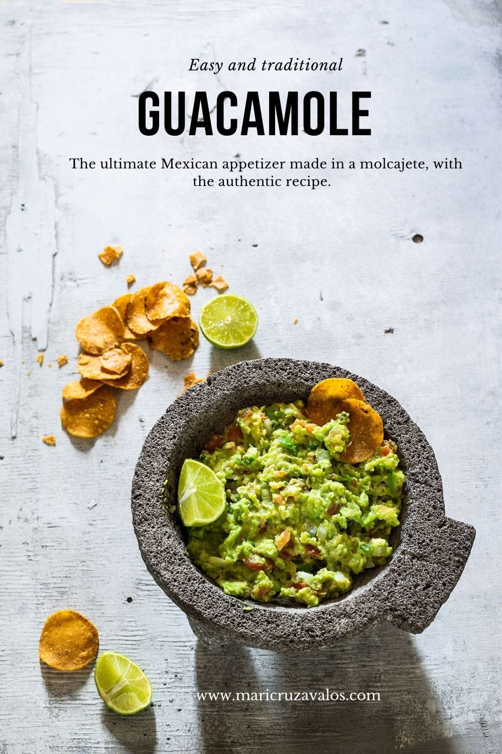 Mexican guacamole on a molcajete with text overlay.