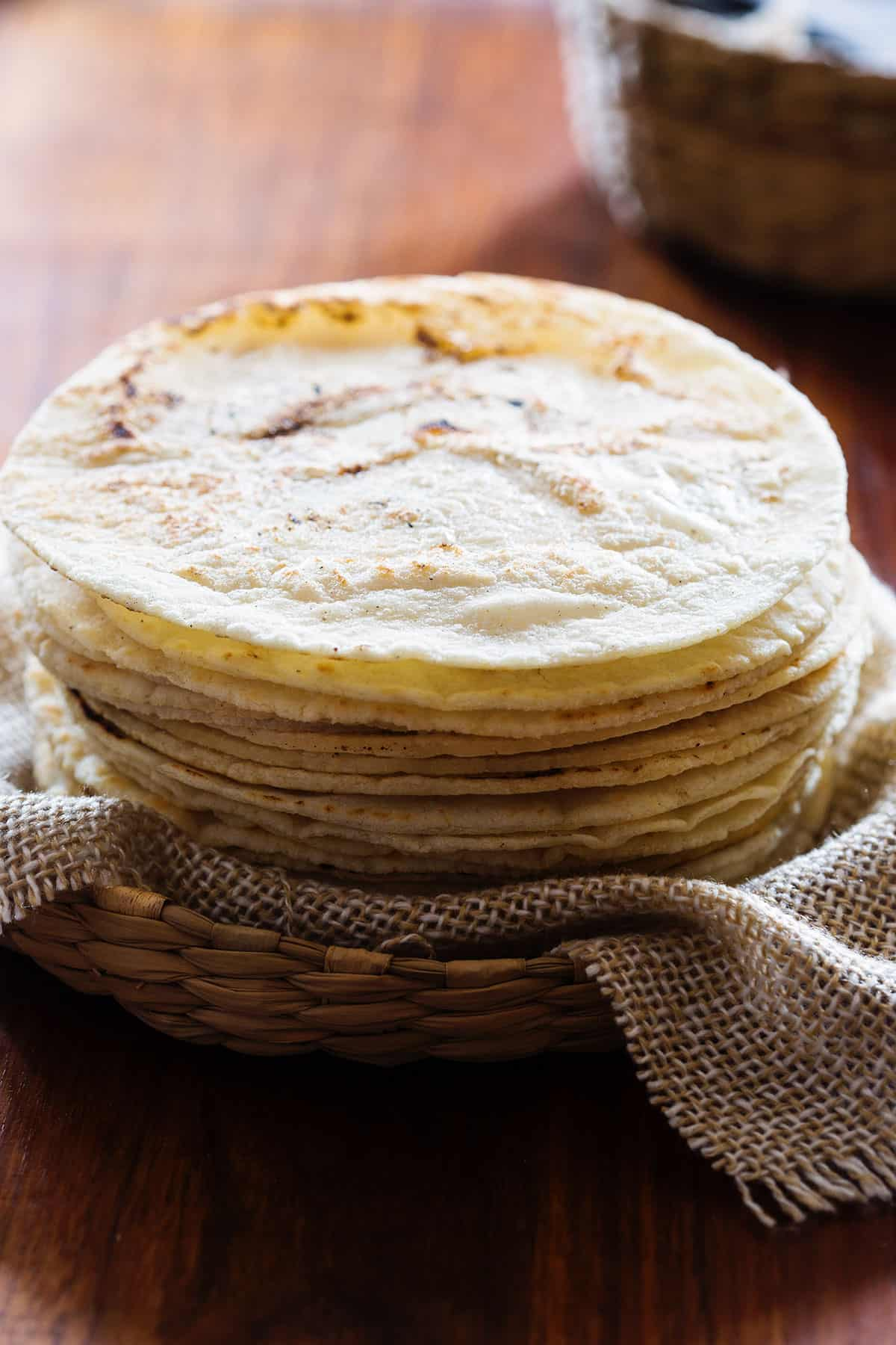 Gluten free corn tortillas on a basket.