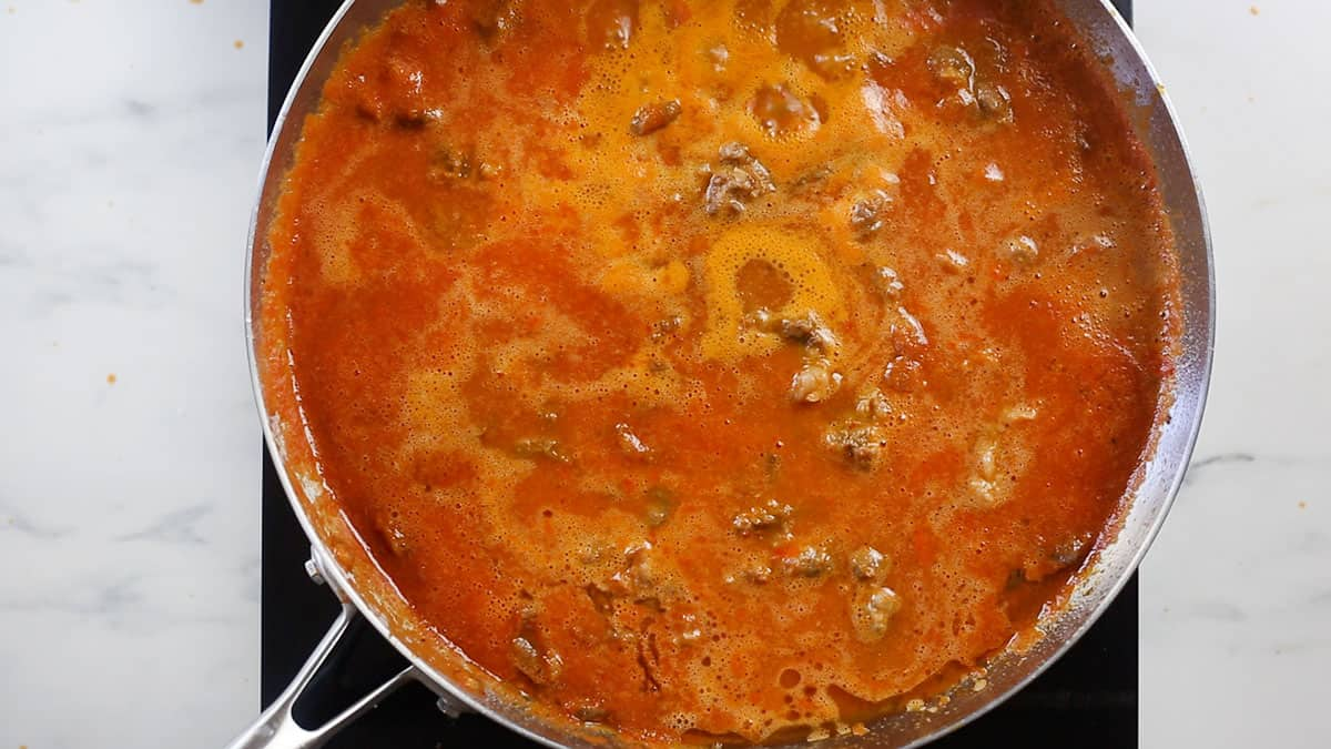 The stew (chile rojo) cooking on a pan.