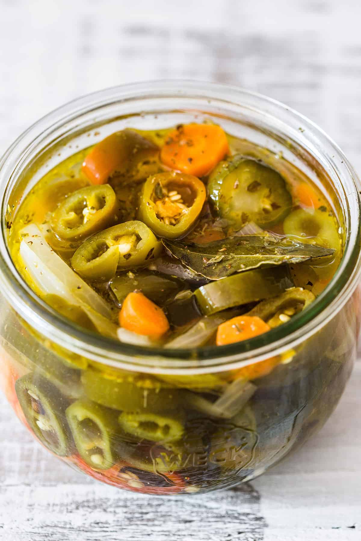 Chiles en vinagre (pickled jalapenos) in a jar.