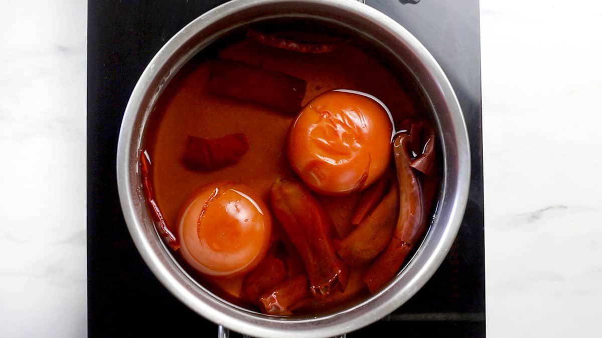 Tomatoes and chilies boiled on a pot.