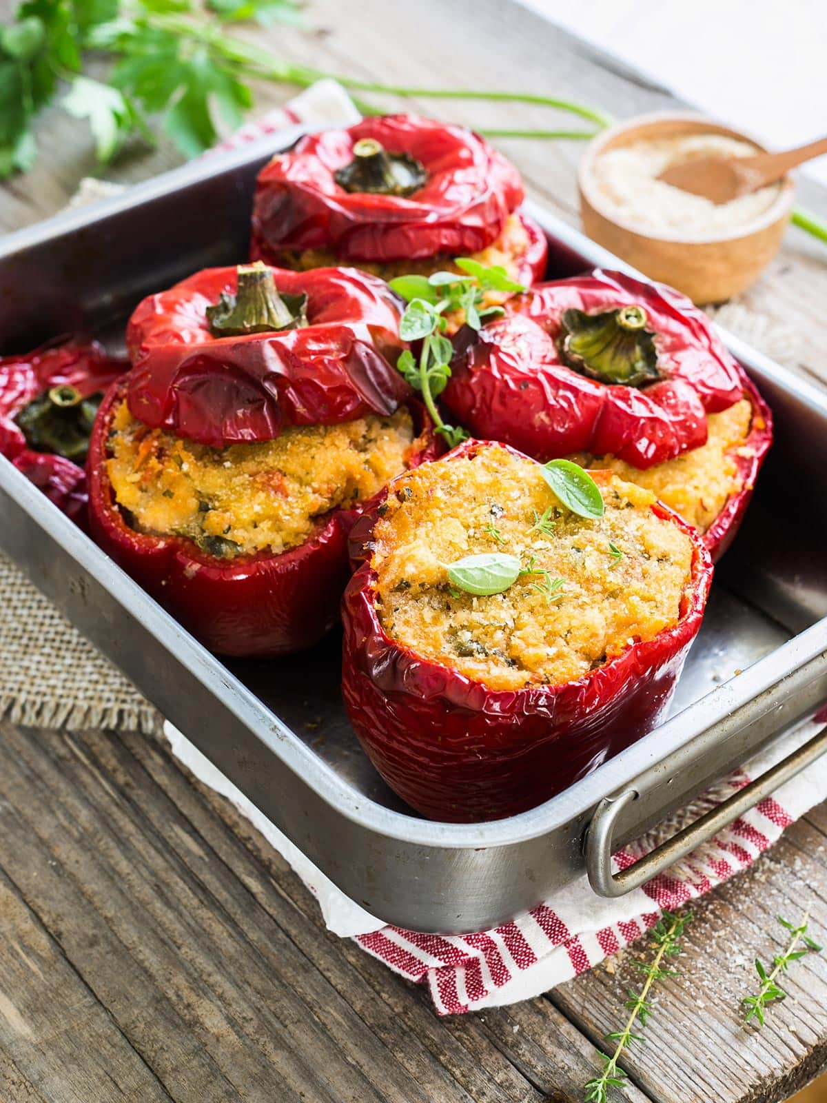 Italian peppers stuffed with breadcrumbs on a baking dish.