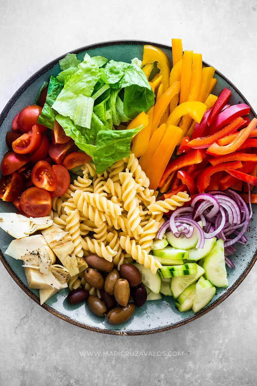 Pasta and vegetables arranged on a plate.