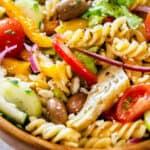 Zesty italian pasta salad on a large bowl.