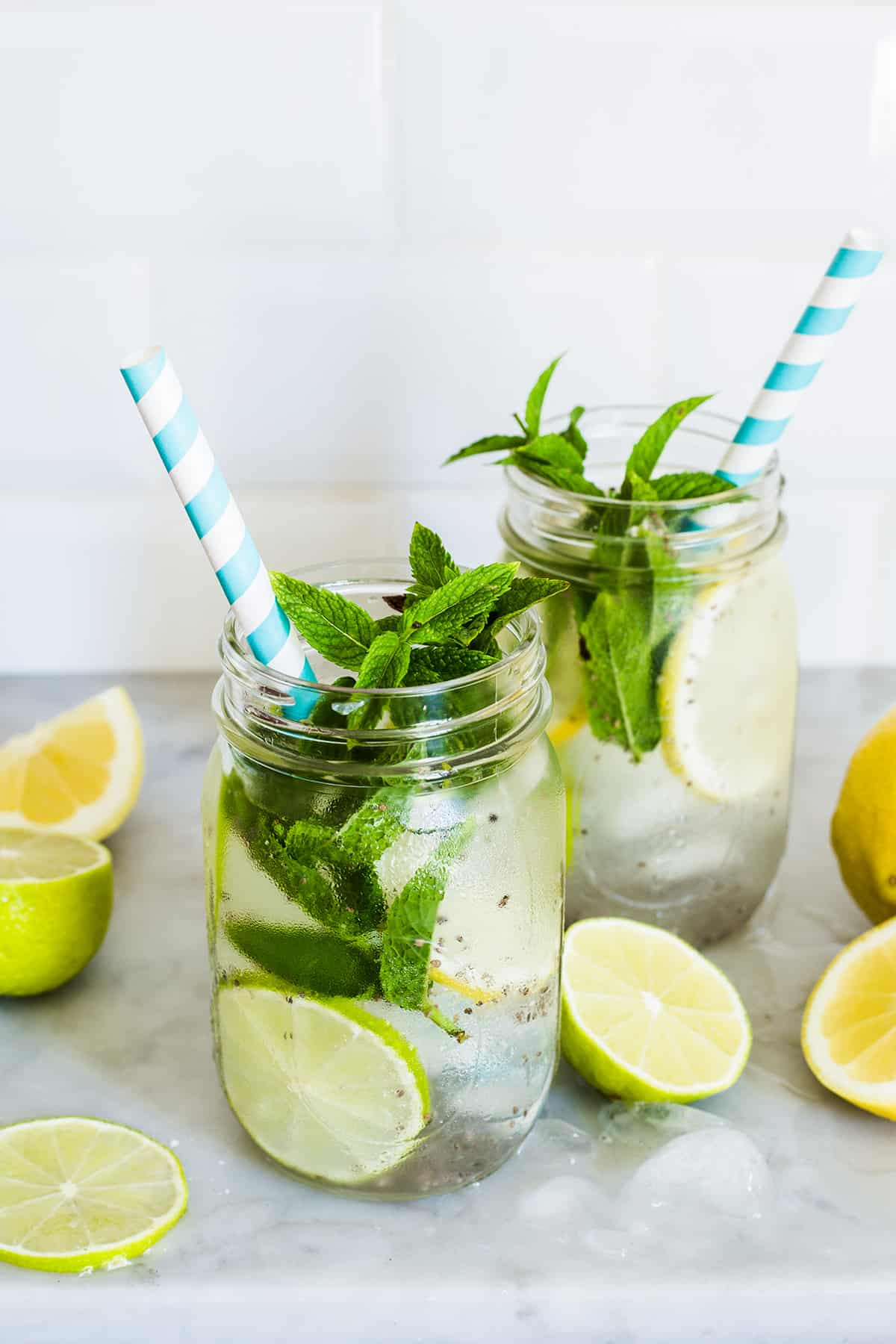 Chia drink with limes, lemons and mint on glasses with ice.