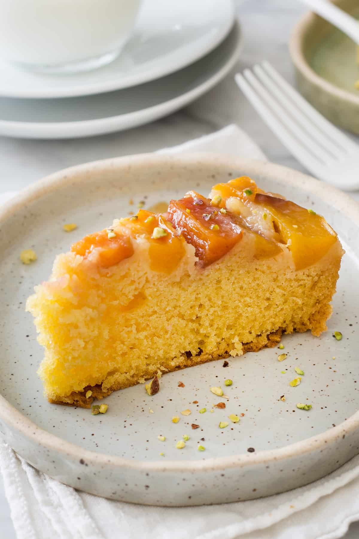 close up to a slice of fresh peach cake