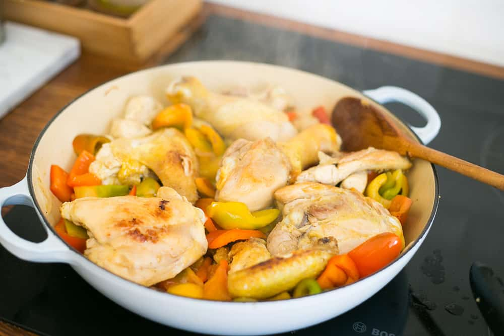 Cooking peppers with chicken.