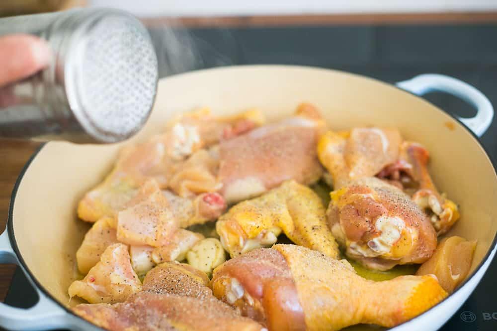 Seasoning chicken with salt.