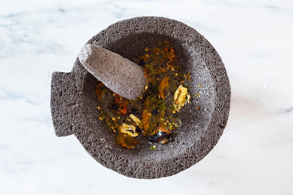Crushed garlic and chilies on a molcajete.