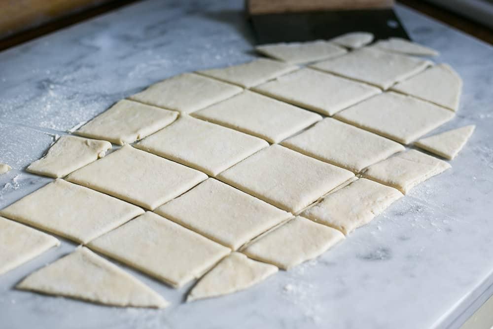 cut pizza dough for Gnocco Fritto
