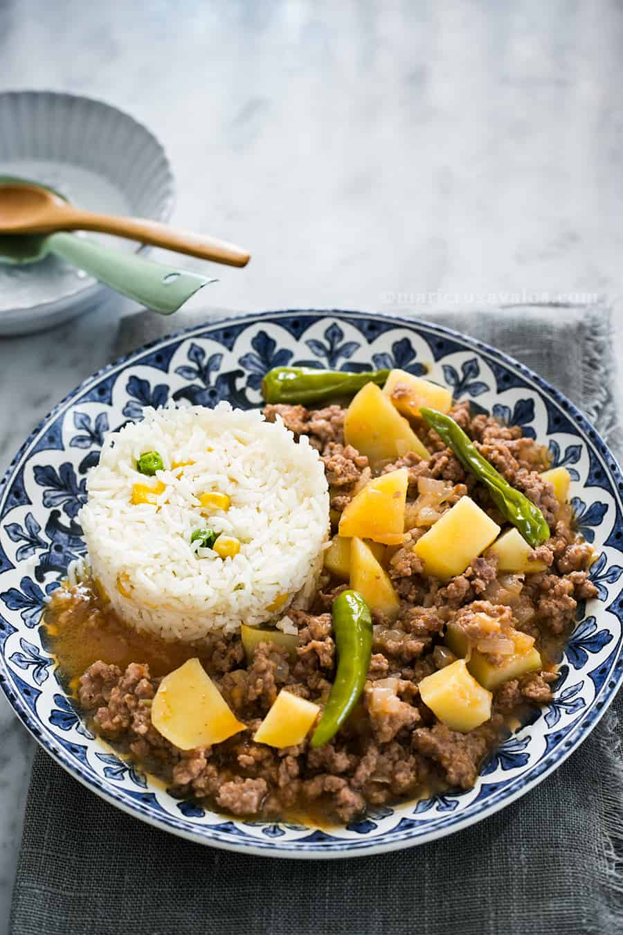 Mexican picadillo recipe with potatoes and white rice as a side dish.
