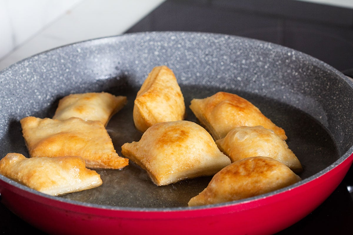 Frying gnocco on a pan.