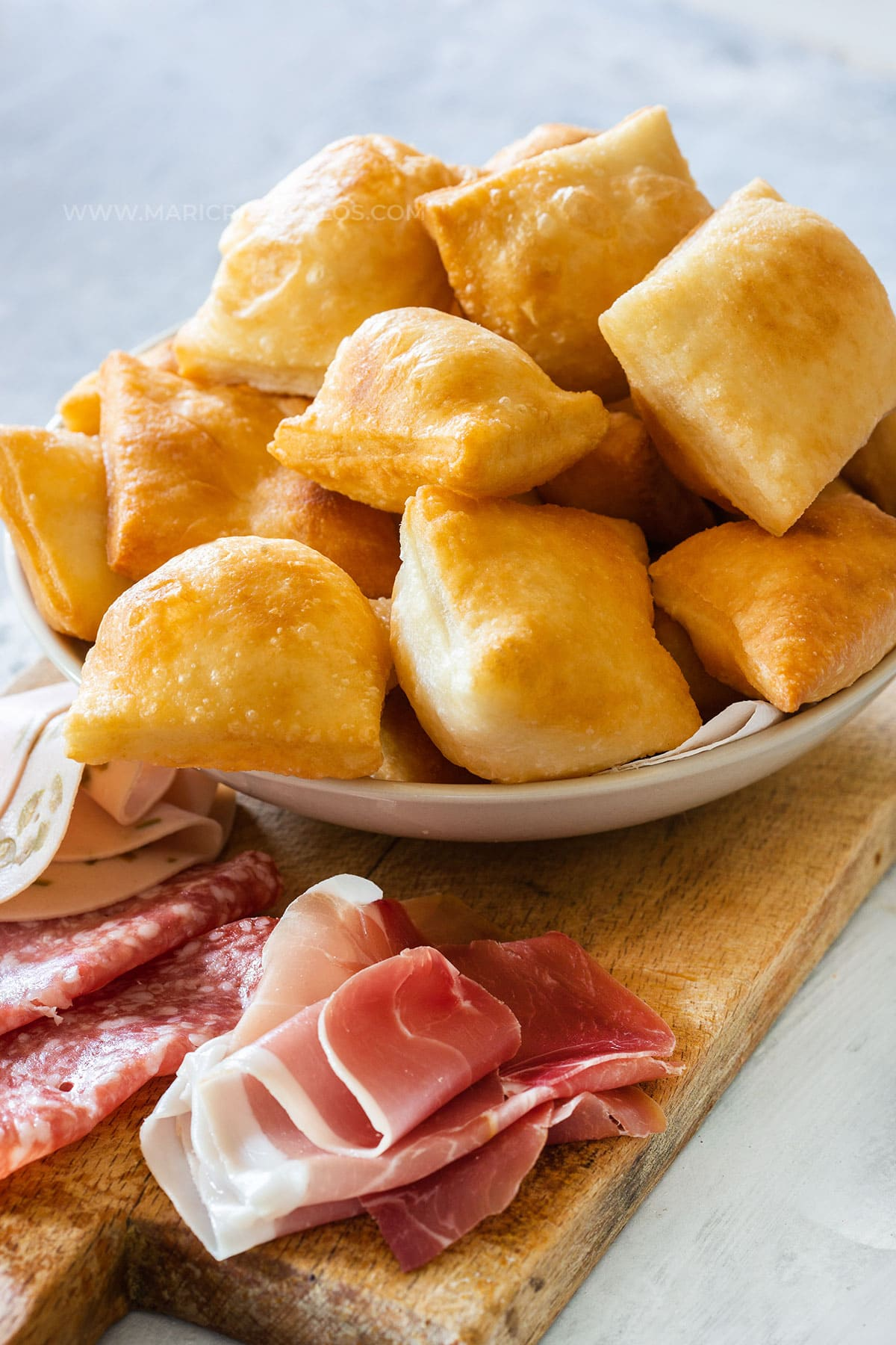 Gnocco fritto served with various cold cuts (prosciutto, salami, etc.)