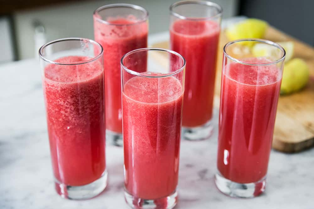 the watermelon mixture on the glasses, before placing in the freezer.