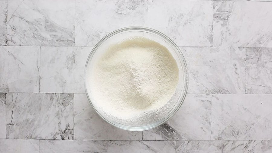 Flour sifted with baking powder and baking soda on a bowl.