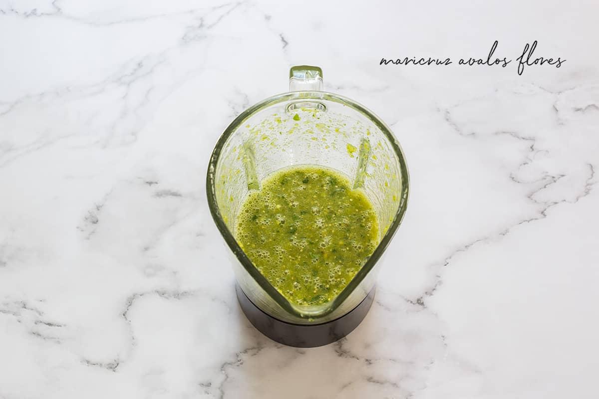 Green sauce on a blender.