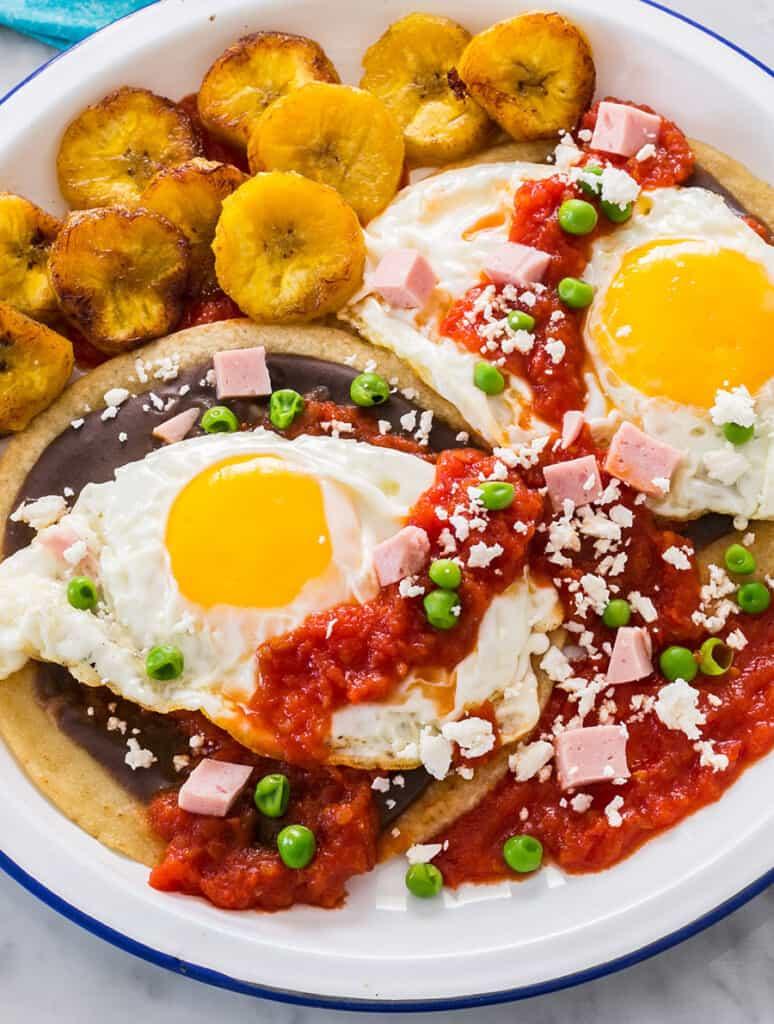 A close up of mexican huevos motulenos.