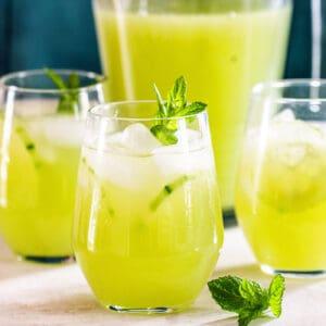 Mexican agua de pepino (cucumber) on glasses.