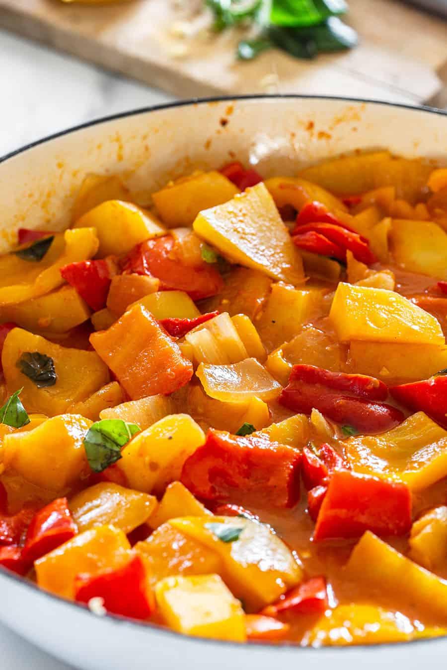 A roman-style peperonata with potatoes on a pan.