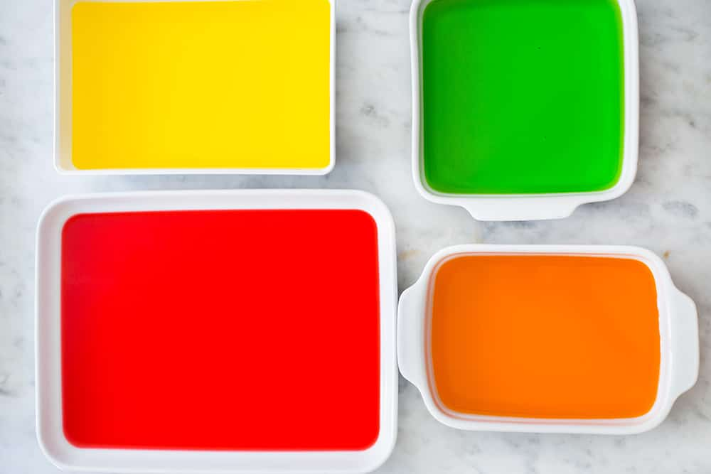 Different flavoured jello on containers.