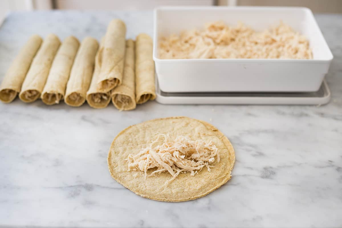Chicken rolled tacos: Flautas. being made