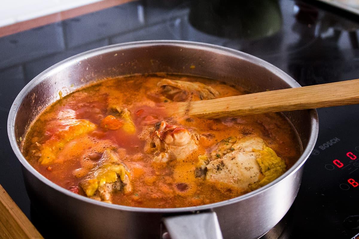 Pollo alla cacciatora | EASY RECIPE | Add the sauce and water, then bring to boil.