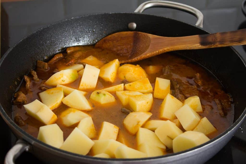 The potatoes added to the pan.