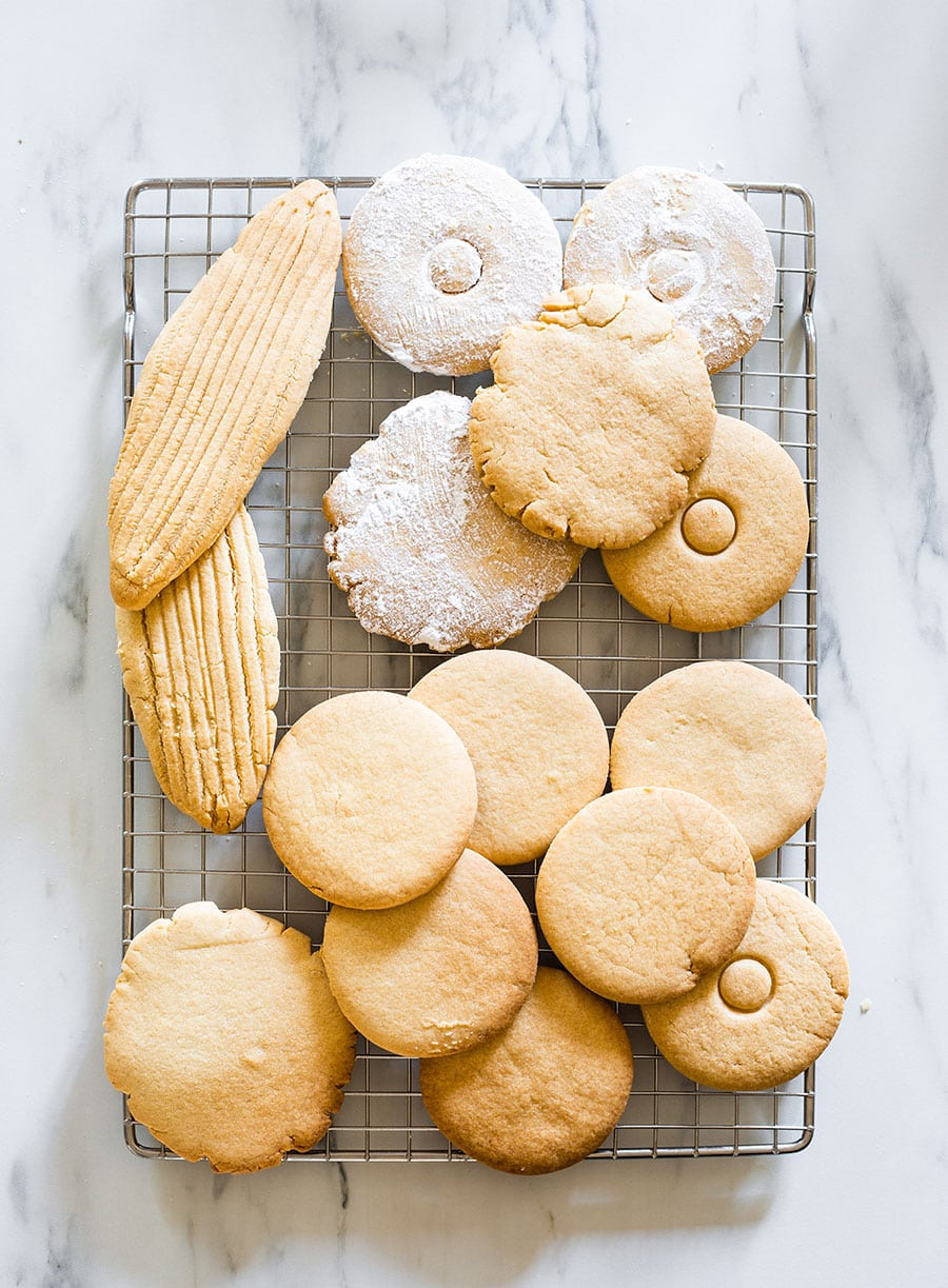 Mexican cookies on a cooling rack.