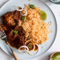 Mexican pork ribs on a plate served with red rice