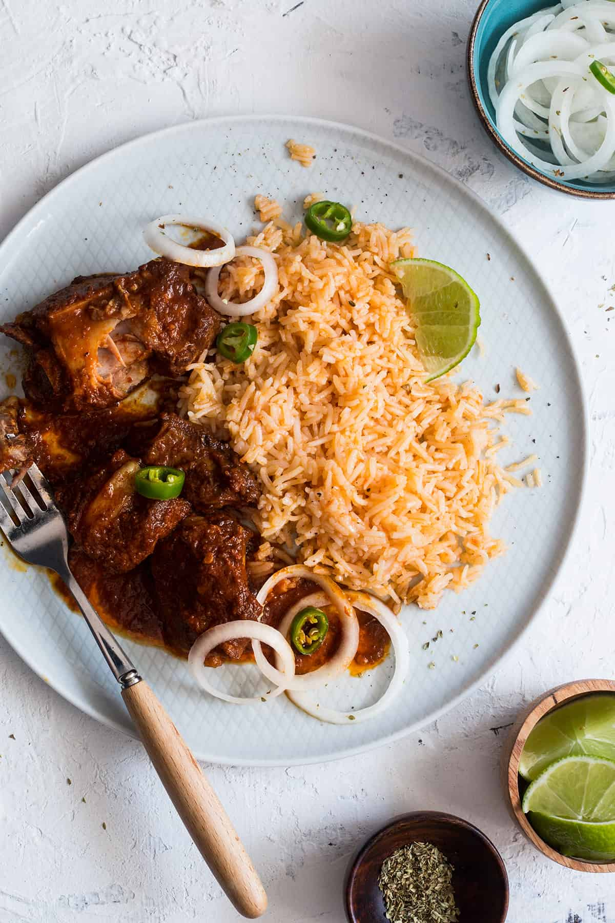 mexican pork ribes on a plate served with red rice