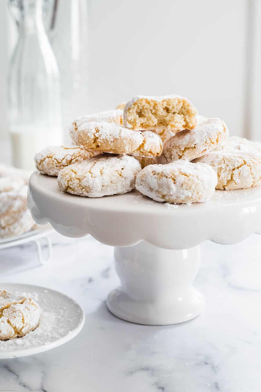 Amaretti cookies on a white cake stand.