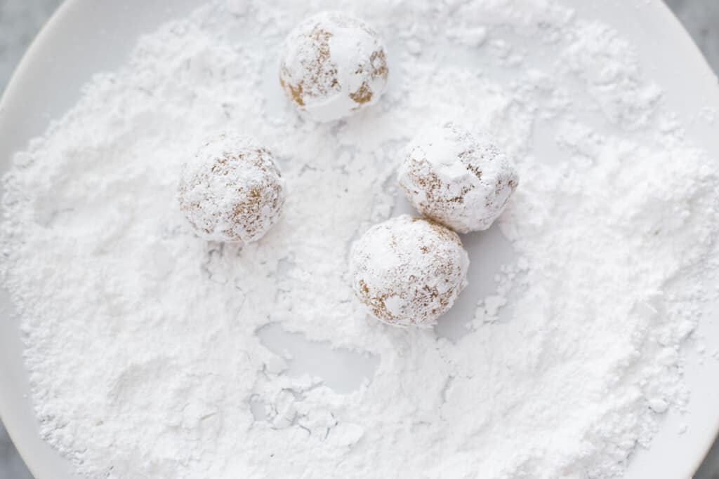 Small balls of dough coated with confectioner's sugar.