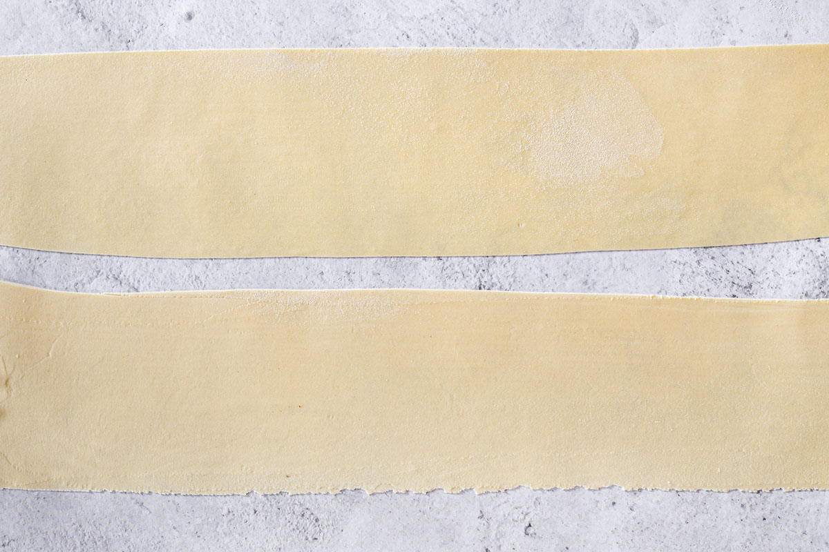 Two rectangles of rolled pasta dough.