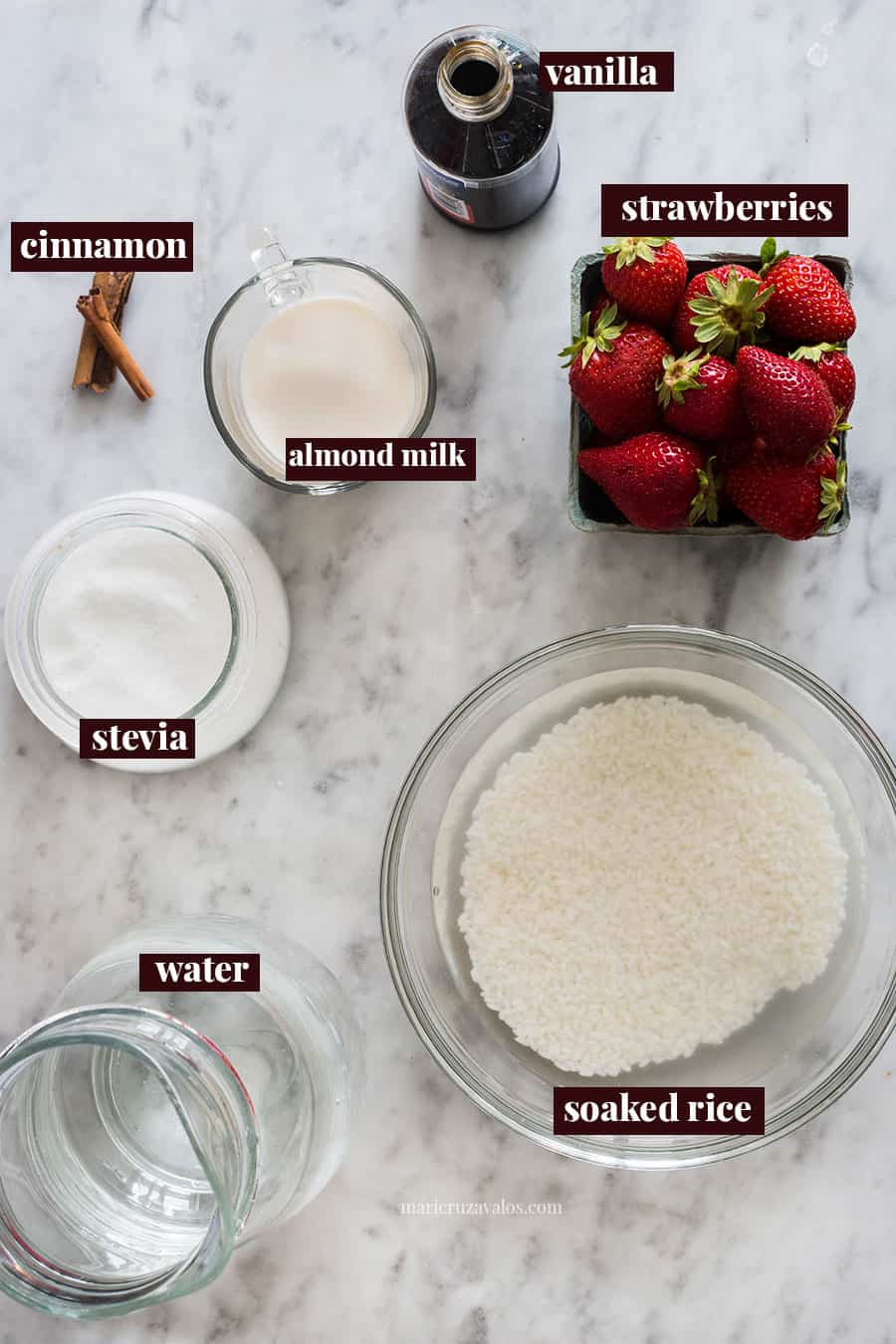 Strawberry horchata ingredients on a marble surface.