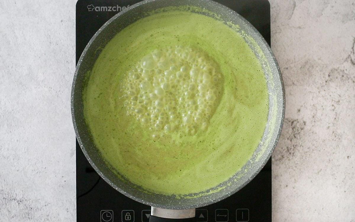 Salsa verde (green sauce) boiling on a pan.