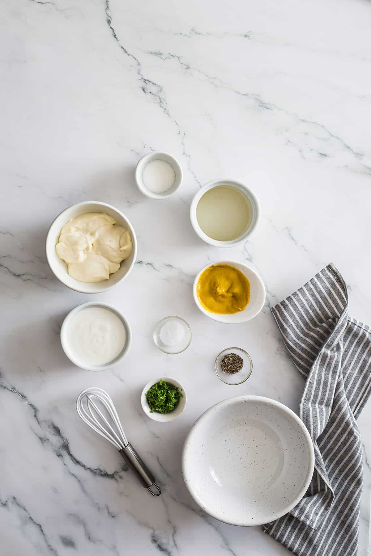 Mayonnaise, mustard, vinegar and other ingredients for pasta salad