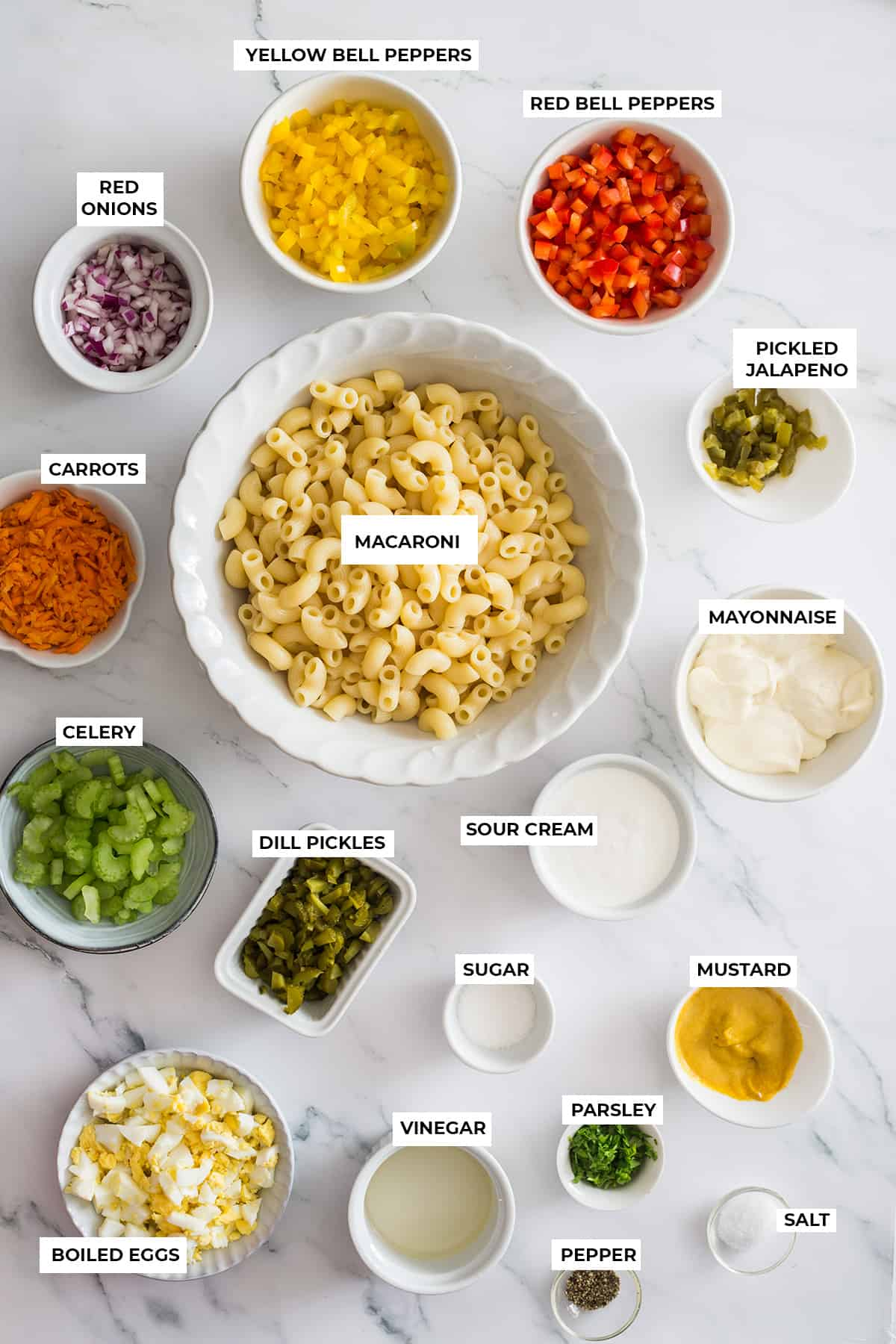All ingredients displayed on bowls on a marble surface.