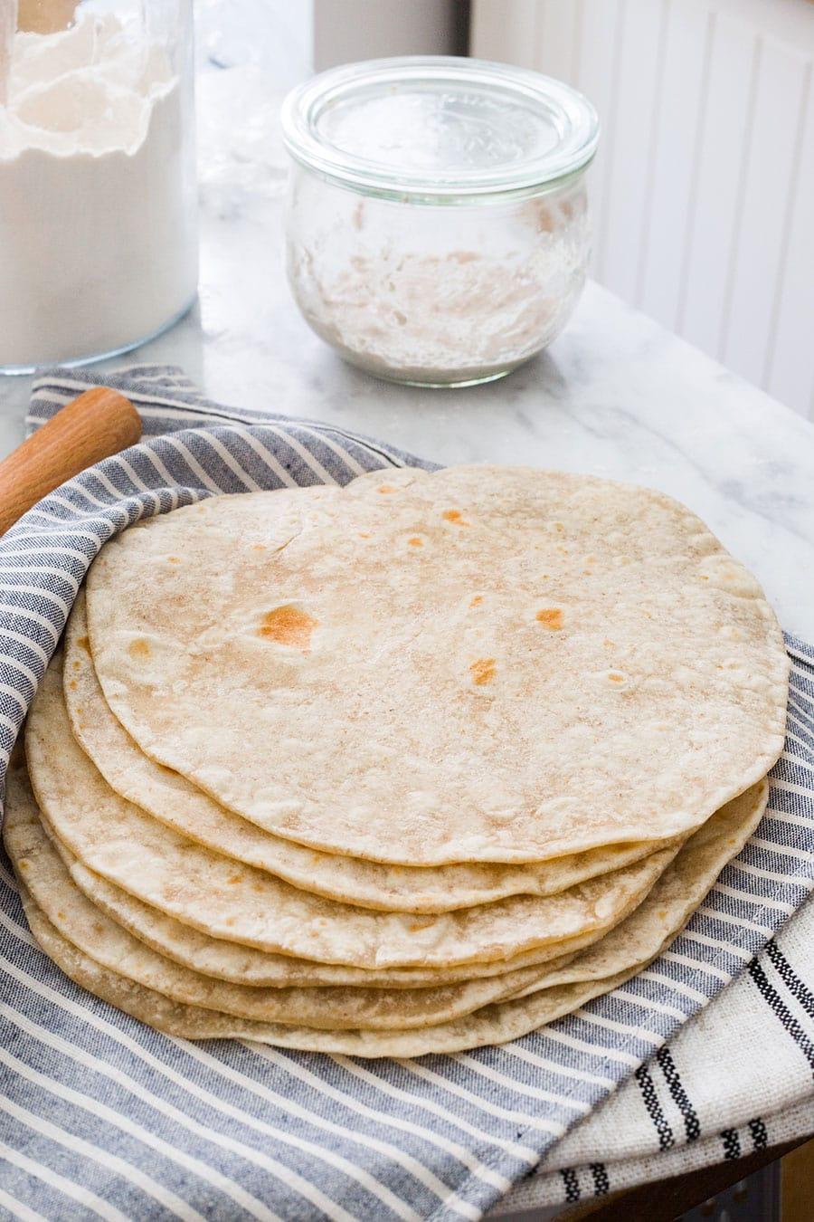 Sourdough tortillas piled.