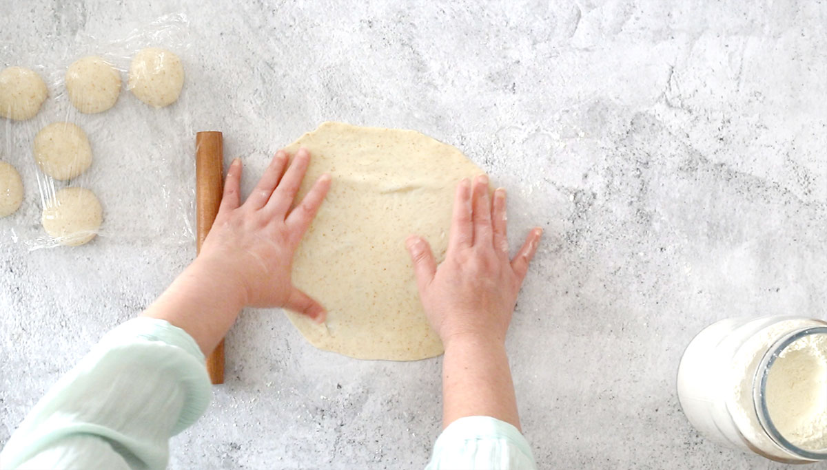 Shapping tortillas with hands.