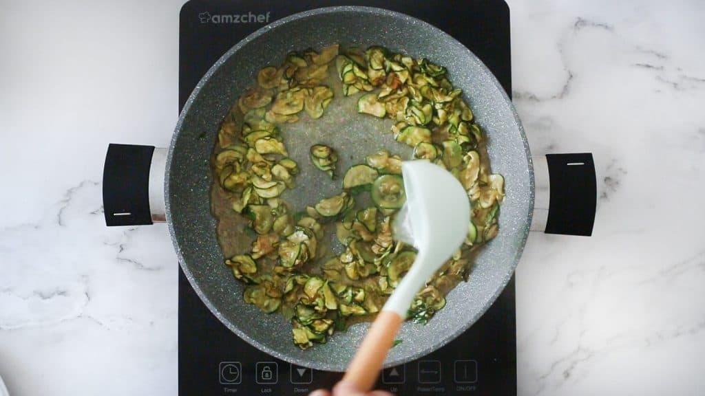 Zucchini rehydrating on the pan.
