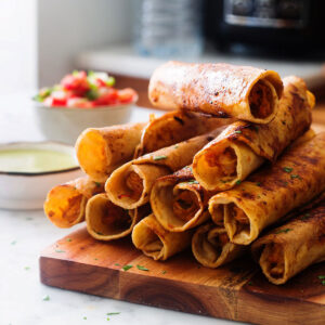 Chicken and cheese taquitos served as appetizers.