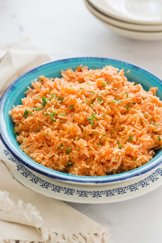 Arroz Rojo on a turquoise deep plate.