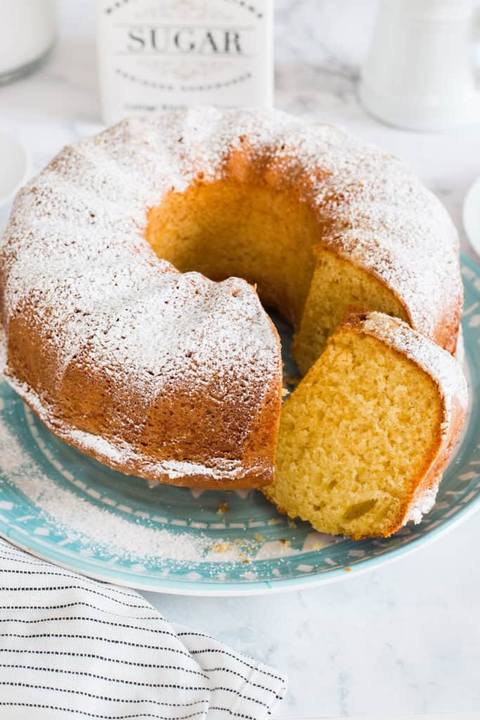 A ciambellone cake placed on a blue serving plate