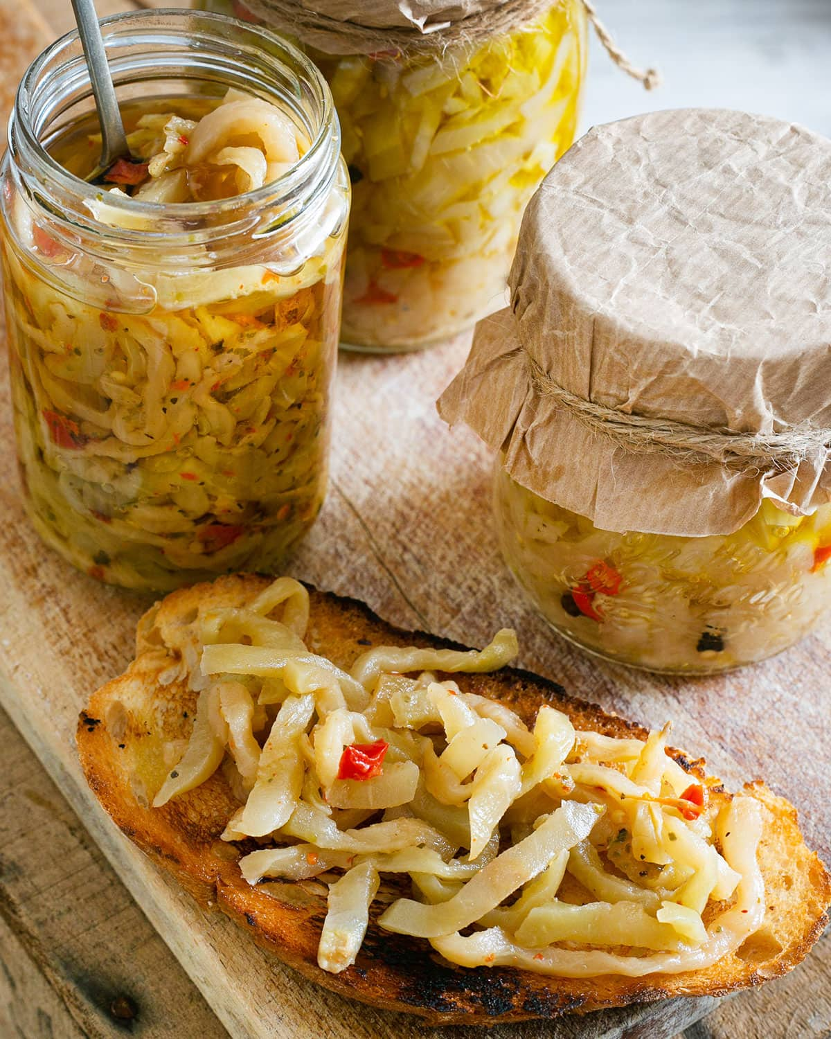 Italian pickled eggplant in jars and served on a bruschetta.