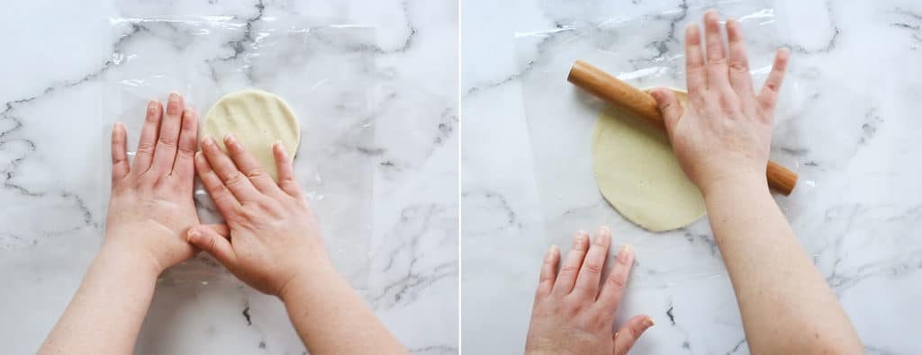 Shapping tortillas with a rolling pin.