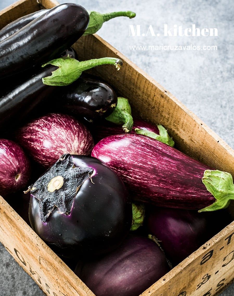 A wood box with various types of Italian eggplants.