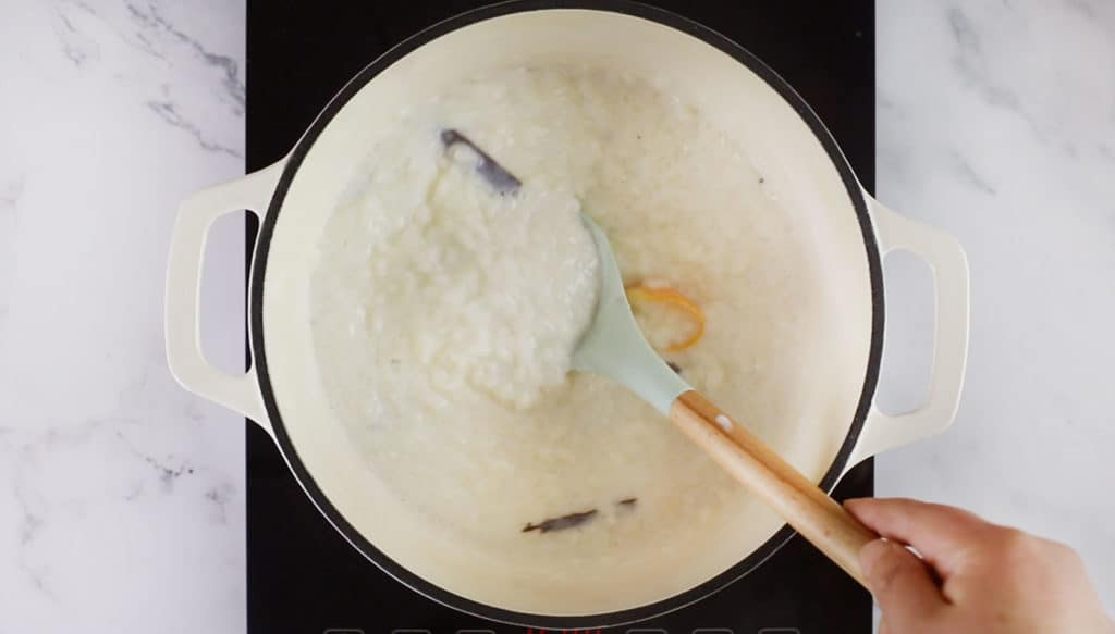 Mixing the arroz con leche with a spoon.