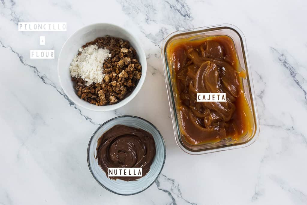 Fillings for Coyotas: Piloncillo + flour, cajeta and nutella. Displayed in bowls.