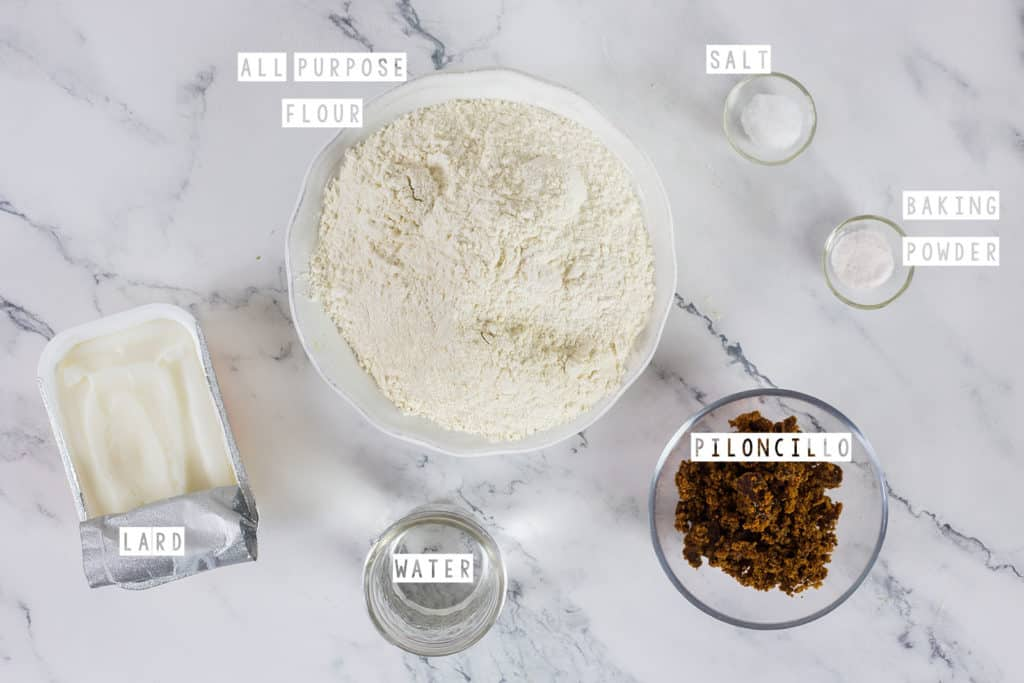 Ingredients for coyotas: All purpose flour, salt, baking powder, piloncillo, water and lard.